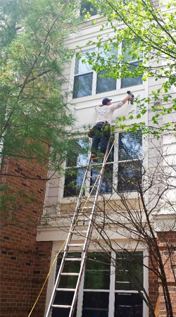 Multi-Family siding repairs in Reston, VA by Reston Painting & Contracting